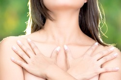 close up, topless woman body covering her breast with hand, cancer awareness