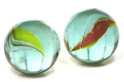 A Pair of Glass Cateye Marbles Isolated on a White Background