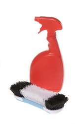 A bottle of household and industrial cleaner with scrub brush isolated on white.