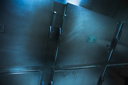 Grungy and high contrast photo of morgue trays