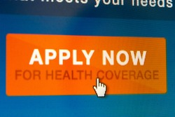 BOISE,IDAHO/USA - DECEMBER 21 2013: Mouse pointer about to click to start the application at Healthcare.gov