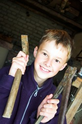 Young boy playing in garage with tools