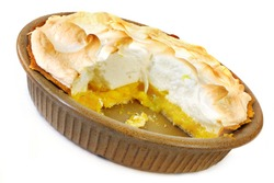 Home-baked lemon meringue pie, with a slice cut out.  Old-fashioned pottery pie plate, isolated on white.
