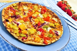 Freshly baked vegetarian pizza with sweet peppers