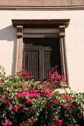 Beautiful window with flowers. City Hall of Almeria in Andalusia, Spain.