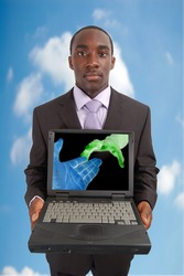 "This is an image of a man holding a laptop. This image can be used represent ""Network"" concepts."