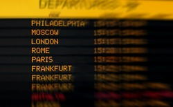 international departure board at an airport