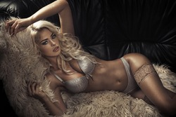 Woman laying on fur chair