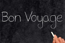 Bon Voyage, have a good trip, written on a blackboard.