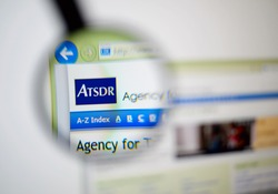 LISBON, PORTUGAL - December 9, 2014: Photo of the Agency for Toxic Substances and Disease Registry (ATSDR) homepage on a monitor screen through a magnifying glass.