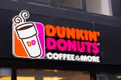 ESSEN, GERMANY - SEPTEMBER 14, 2014: Dunkin' donuts sign. Since its founding, the company has grown to become one of the largest coffee and baked goods chains in the world, with 11,000 restaurants.