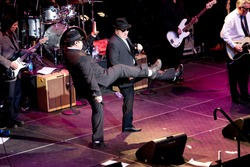 ATLANTA - FEB 7: Musical group, The Blues Brothers, featuring actors, Dan Aykroyd (L) and Jim Belushi (C) perform at The Tabernacle on February 7, 2009 in Atlanta, Georgia for the Hilles of Ga Benefit.