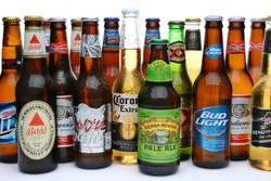 IRVINE, CA - JULY 14, 2014: An assortment of domestic and imported beers on white. Brands include, Coors, Budweiser, Corona, Bass, MGD, Miller Lite, Sierra Nevada, Samuel Adams, Dos Equis.