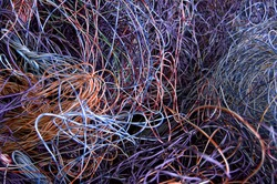 Telephone wires gathered for recycling. There is plastic and copper to recover.