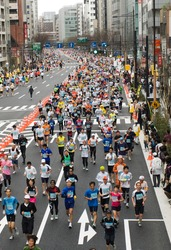 TOKYO – MARCH 22 : Top view of runners at Tokyo Marathon held on March 22, 2009 in Tokyo, Japan. Kenyan Salim Kipsang won the Tokyo Marathon in 2 hours, 10 minutes, 27 seconds.
