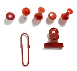 close up of various red pushpins  on white background with clipping path