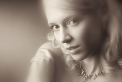 Young woman romantic portrait. Special blur effect to add some haze. Sepia retro colors.