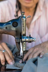 The vintage sewing machine on old man designer blur background