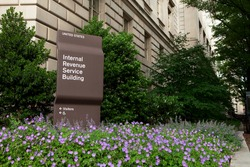 WASHINGTON, DC - JUNE 6: Colorful flowers bloom outside the Internal Revenue Service building in downtown Washington, DC on June 6, 2015.