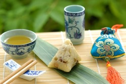 Chinese Glutinous Rice Dumpling(glutinous rice wrapped to form a pyramid using bamboo or reed leaves),People eat this food at Dragon Boat Festival(5th day of the 5th lunar month).