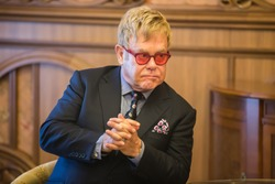 KIEV, UKRAINE - Sep 12, 2015: World-famous musician, composer and singer Elton John well-known in world for his charitable activity in fight against AIDS against his meeting with President of Ukraine