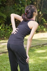 asian woman experiencing backache after exercise
