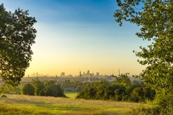 The City of London Cityscape at Sunrise with early Morning Mist from Hampstead Heath. Buildings include the Shard, Gherkin 30 St Mary Axe, St Pauls, Lloyds Building, Stock Exchange and Walkie Talkie.