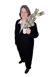 Handsome attractive businesswoman in suit with a cup of coffee in hand filled with money with a happy expression on white background