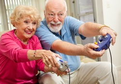 Senior couple having fun playing video games.