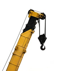 Yellow construction crane on a white background