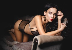 brunette babe on sofa looking glamorous