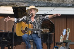 NEW YORK - JULY 30: Musician Arlo Guthrie gestures as he performs at Battery Park's Castle Clinton on July 30, 2009 in New York City.