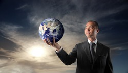 japanese businessman holding planet earth