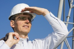 Engineer searching in front of steel construction