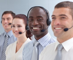 Afro-American businessman working in a call center standing in a line