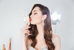 classy girl kissing champagne flute
