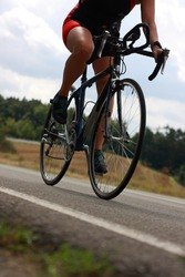 female triathlete on bicycle with slight motion blur