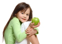 a girl with a green apple