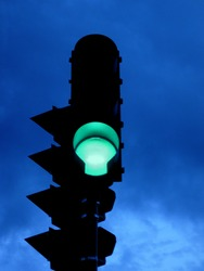 Green light against dark clouds