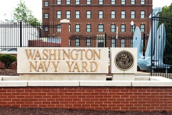 WASHINGTON, DC - JULY 17: Entrance to the Washington Navy Yard in Washington, DC on July 17, 2015. The Navy Yard is the former shipyard and ordnance plant of the United States Navy.