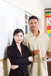 chinese teacher and african american students in classroom