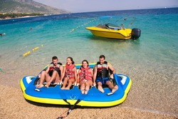 Group of four getting ready for bouncing fun on Croatian coast