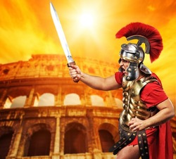 Roman legionary soldier in front of coliseum