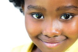 Extreme close up face shot of beautiful little african girl isolated on white background.