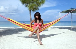 Beautiful women in the hammock on the beach