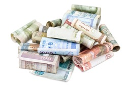 some rolled bank papers of different countries, clipping path