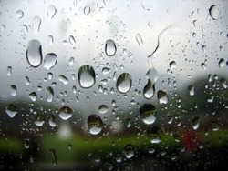 Rainy Day -- big drops on a window pane