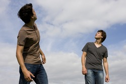 Two young men looking up to the sky