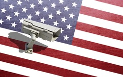Security CCTV camera surveillance system on the broken dirty background USA flag