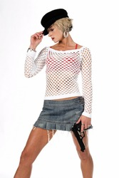Sexy OC blonde fashion diva in a denim skirt, net top and red bra with a 45 caliber handgun at her side.  isolated over white.